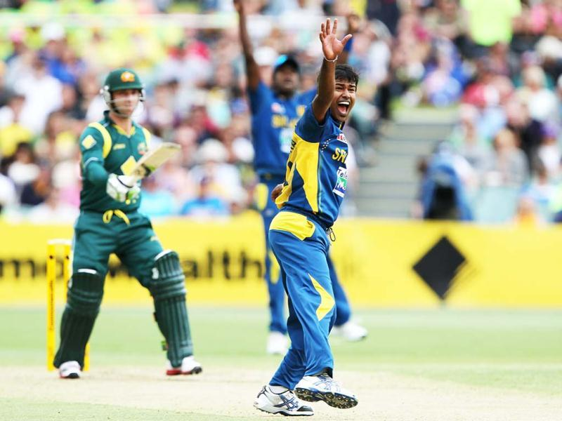 Sri Lanka's Nuwan Kulasekara appeals for the wicket of Australia's Phillip Hughes during their One Day International cricket match in Adelaide, Australia. AP Photo