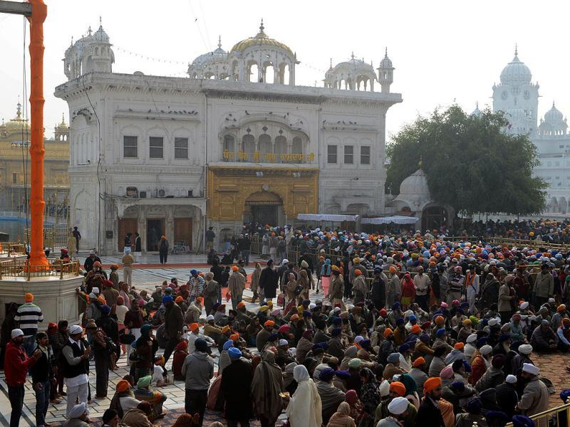 Sikhs pay their respects during the Maghi Mela at the Sikh Shrine Golden Temple in Amritsar. AFP photo