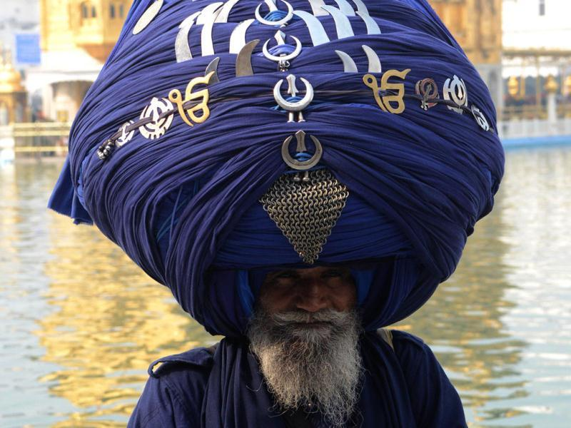 A member of the Sikh Nihang Army, a traditional Sikh religious warrior, wearing a turban of over 300 metres in length poses for a photo during the Maghi Mela festival at the Sikh Shrine Golden Temple in Amritsar. AFP photo
