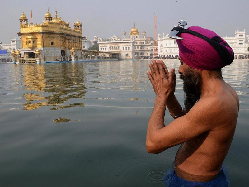 A devotee prays during the Maghi Mela festival at the Sikh Shrine Golden Temple in Amritsar. AFP photo