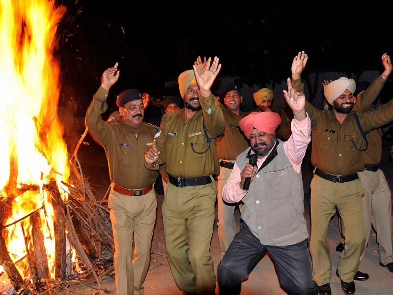 CRPF jawans and officers celebrate Lohri festival at Amritsar. PTI photo