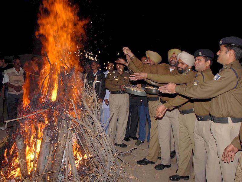CRPF jawans gather around a bonfire as they celebrate the festival of Lohri in Amritsar. UNI photo