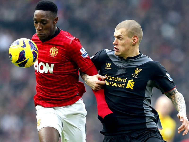 Liverpool's Martin Skrtel (R) challenges Manchester United's Danny Welbeck during their English Premier League soccer match at Old Trafford in Manchester, northern England. Reuters