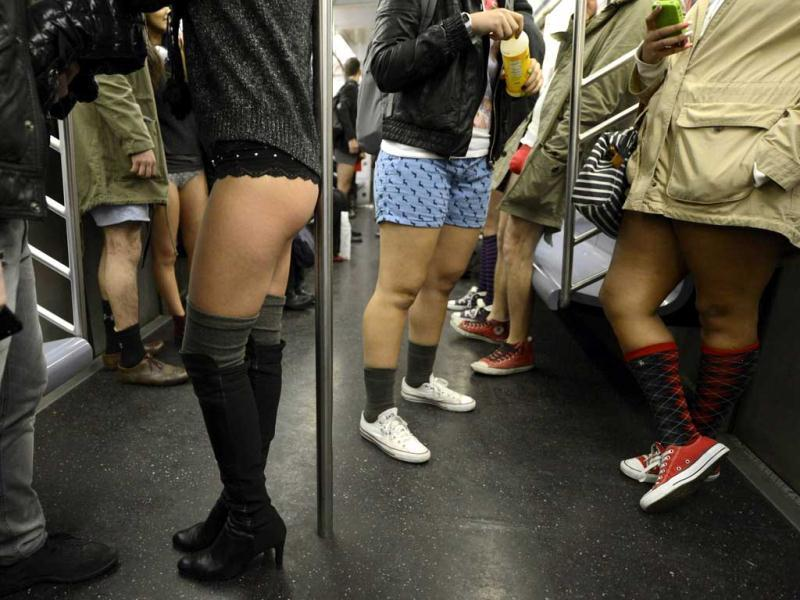 A few riders in the New York City subway in the underwear as they take part in the 2013 No Pants Subway Ride. The goal is for riders to get on the subway train dressed in normal winter clothes (without pants) and keep a straight face. (AFP Photo)