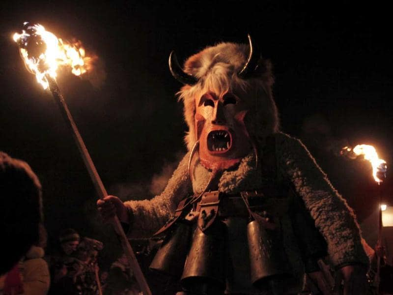 A Bulgarian masked Kukeri dancer performs a ritual in the town of Batanovtsi. Kukeri is a pagan Bulgarian ritual of Thracian origins, performed by costumed men in sheepskin garments and masks, who dance to scare away the evil spirits, in hope to provide a good harvest, health, fertility, and happiness. (AP Photo)
