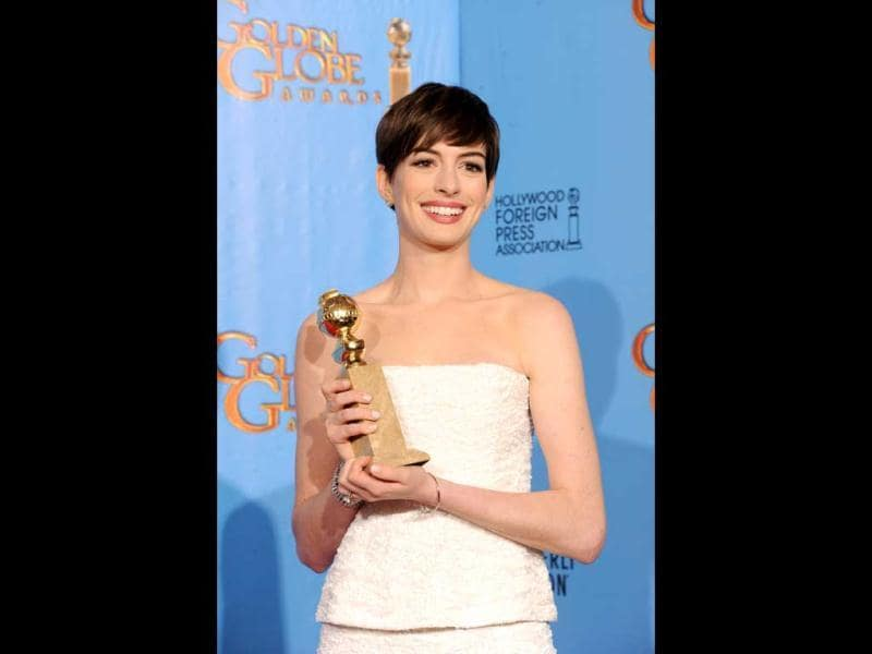 Actress Anne Hathaway poses with Best Supporting Actress Award at the 70th Annual Golden Globe Awards held at The Beverly Hilton Hotel on January 13, 2013 in Beverly Hills, California. Anne Hathway was given the award for her performance in Les Miserables. (Kevin Winter/Getty Images/AFP Photo)