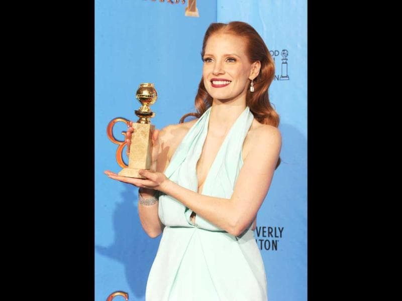 Jessica Chastain poses with Best Actress in a Drama Award (for her performance in Zero Dark Thirty) at the 70th Annual Golden Globe Awards. (Kevin Winter/Getty Images/AFP Photo)