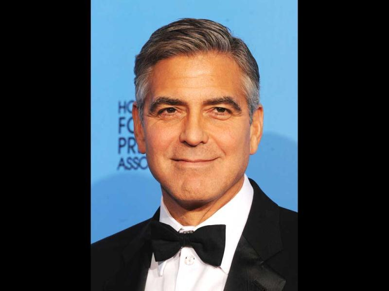 Producer George Clooney, winner of Best Motion Picture (Drama) for Argo, at the 70th Annual Golden Globe Awards held at The Beverly Hilton Hotel on January 13, 2013 in Beverly Hills, California. (Kevin Winter/Getty Images/AFP== Photo)