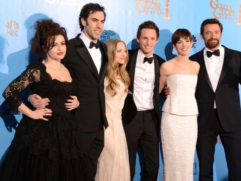 From L to R, actors Helena Bonham Carter, Sacha Baron Cohen, Amanda Seyfried, Eddie Redmayne, Anne Hathaway and Hugh Jackman pose with the best motion picture comedy or musical award for Les Miserables at the Golden Globes awards ceremony in Beverly Hills. (AFP PHOTO)