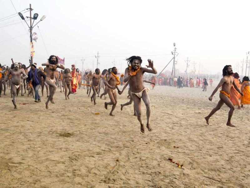 Naga sadhus run to take a dip in the Ganges at the ongoing Kumbh Mela in Allahabad. Reuters/Ahmad Masood