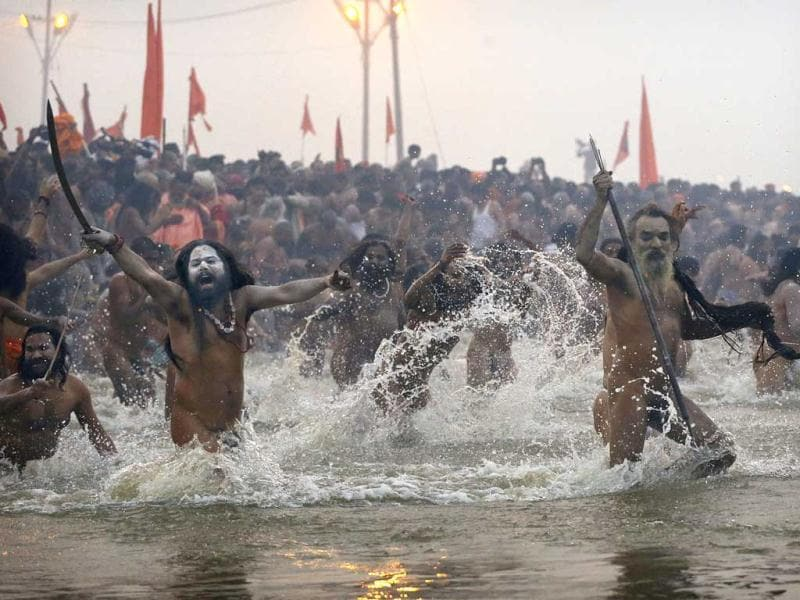 Naga Sadhus, run into the water at Sangam, during the royal bath at the start of the Maha Kumbh Mela in Allahabad. AP/Kevin Frayer