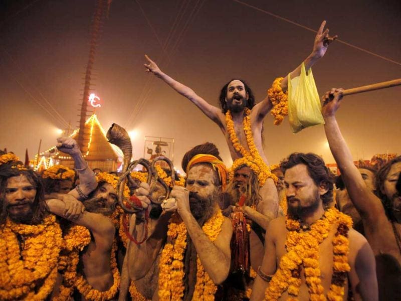 Naga sadhus leave from their camp for a dip at Sangam in Allahabad. AP/Rajesh Kumar Singh