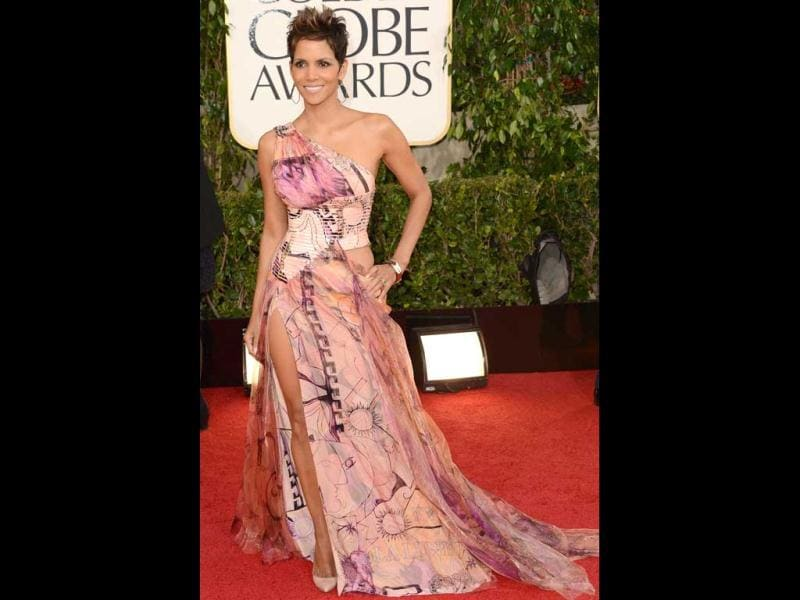 Actress Halle Berry looks hot in a printed gown with a sexy slit on it. (AFP Photo)