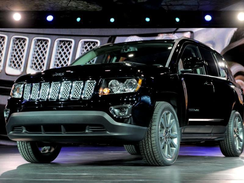 The 2014 Jeep Compass is introduced at the 2013 North American International Auto Show in Detroit, Michigan. AFP PHOTO/Stan HONDA