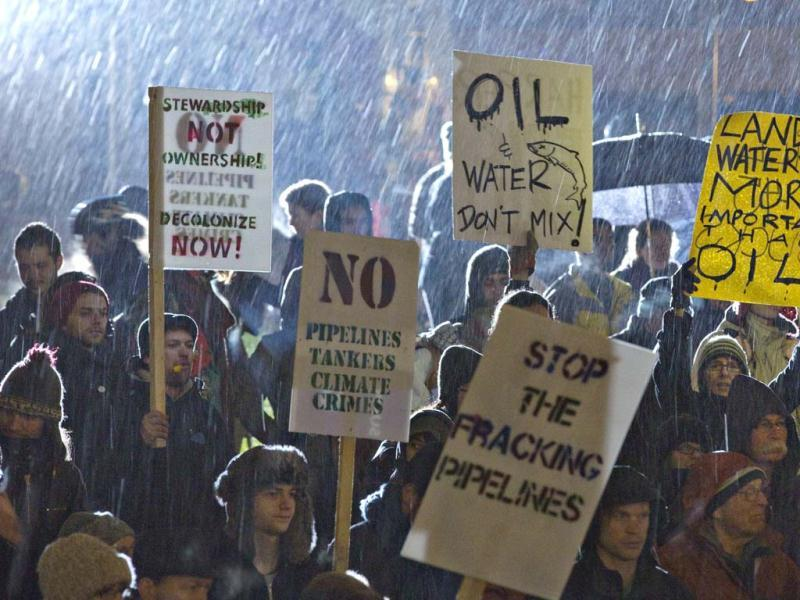 Protestors stand in the rain during a rally against the proposed Enbridge Northern Gateway pipeline project in Vancouver, British Columbia. The Northern Gateway Pipeline public hearings have begun four days of meetings in Vancouver. Reuters Photo