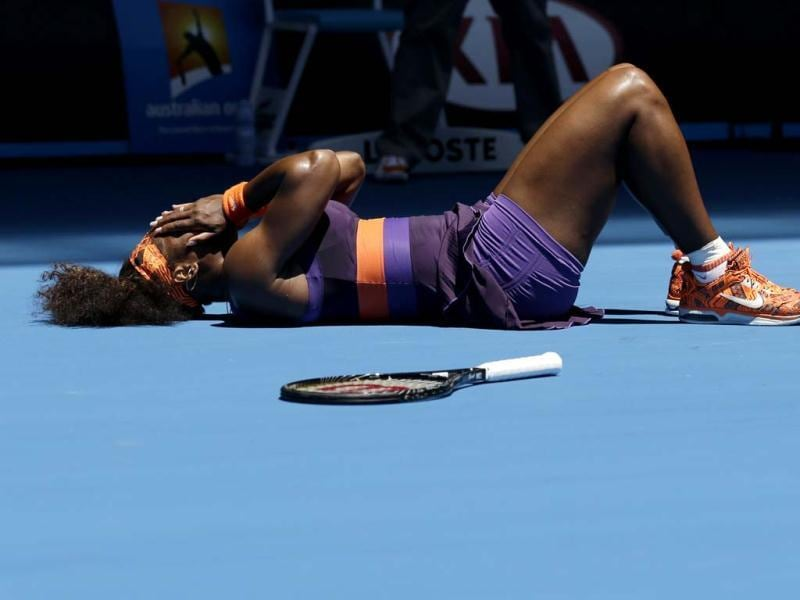 Serena Williams lies on the court after falling during her first round match against Romania's Edina Gallovits-Hall at the Australian Open tennis championship in Melbourne. AP Photo
