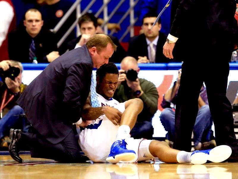 Ben McLemore #23 of the Kansas Jayhawks is attended to after getting hurt during the 2nd half of the game against the Baylor Bears at Allen Fieldhouse in Lawrence, Kansas. AFP Photo
