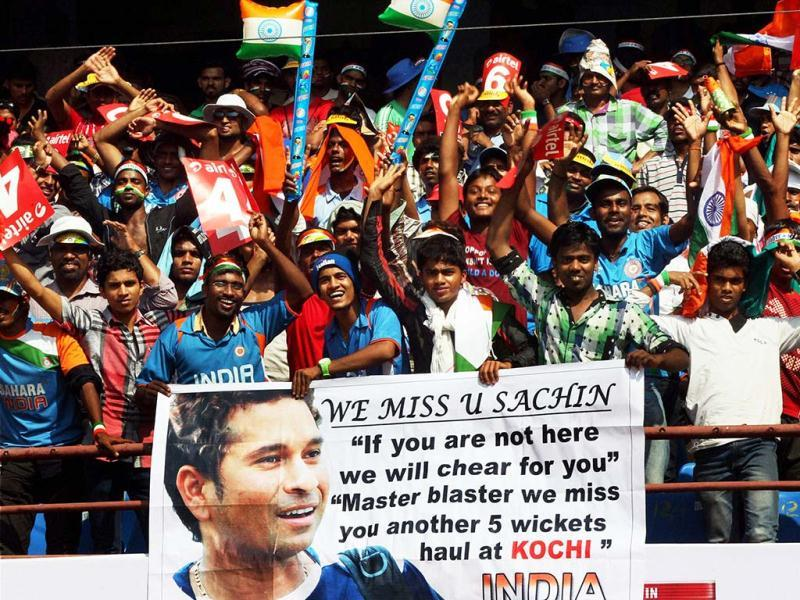 Fans display a poster of master blaster Sachin Tendulkar during the 2nd ODI cricket match against England in Kochi. PTI Photo