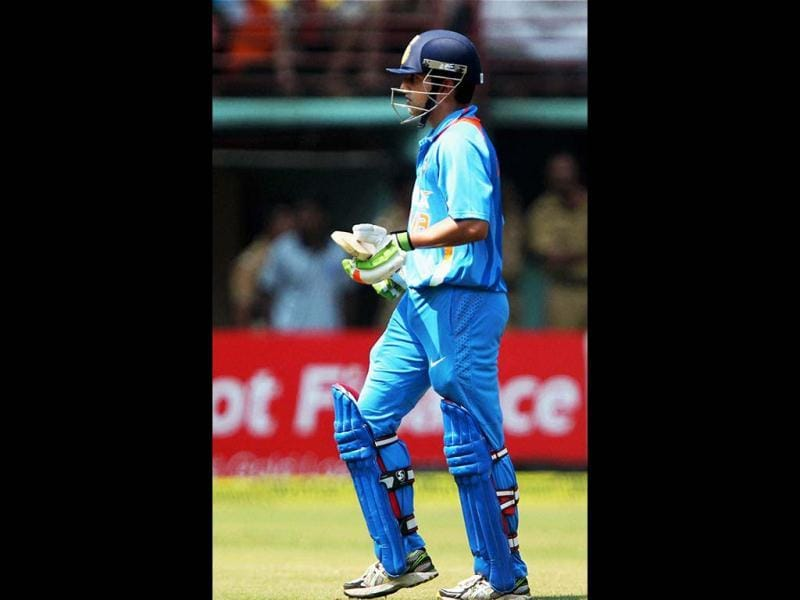 Gautam Gambhir after his dismissal during the 2nd ODI cricket match against England in Kochi. PTI Photo
