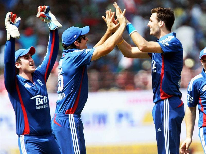 England's Steve Finn celebrates with team mates after dismissing Ajinkya Rahane during the 2nd ODI match in Kochi. PTI Photo
