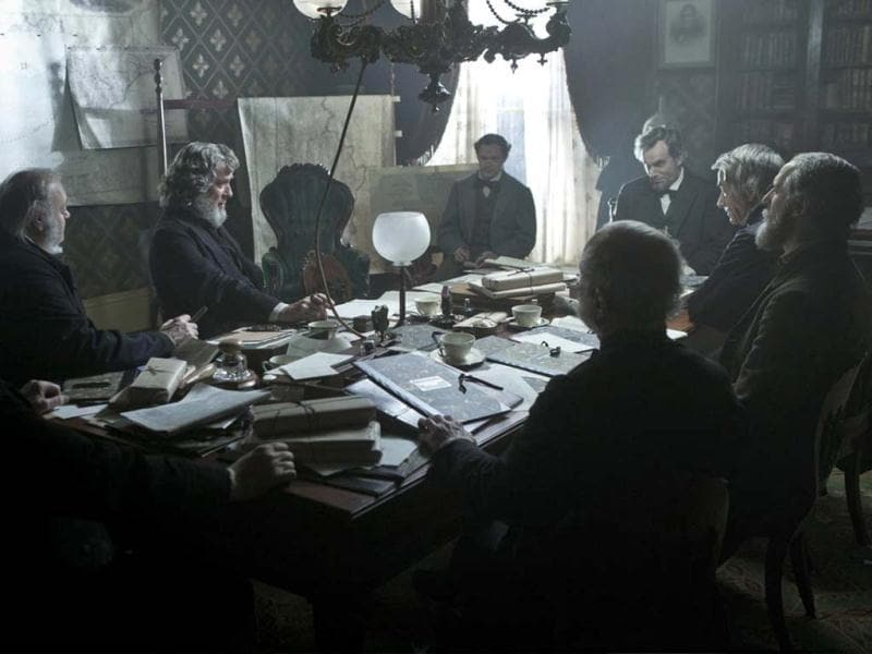 President Lincoln (Daniel Day-Lewis, far right) meets with his Cabinet to discuss the planned attack on Fort Fisher in this scene from director Steven Spielberg's drama Lincoln from DreamWorks Pictures and Twentieth Century Fox.