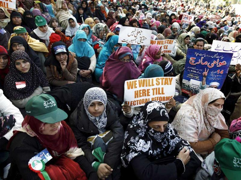 Supporters of Sufi cleric and leader of the Minhaj-ul-Quran religious organisation Muhammad Tahir -ul-Qadri listen to his speech on the second day of protests in Islamabad, Pakistan. (Reuters)