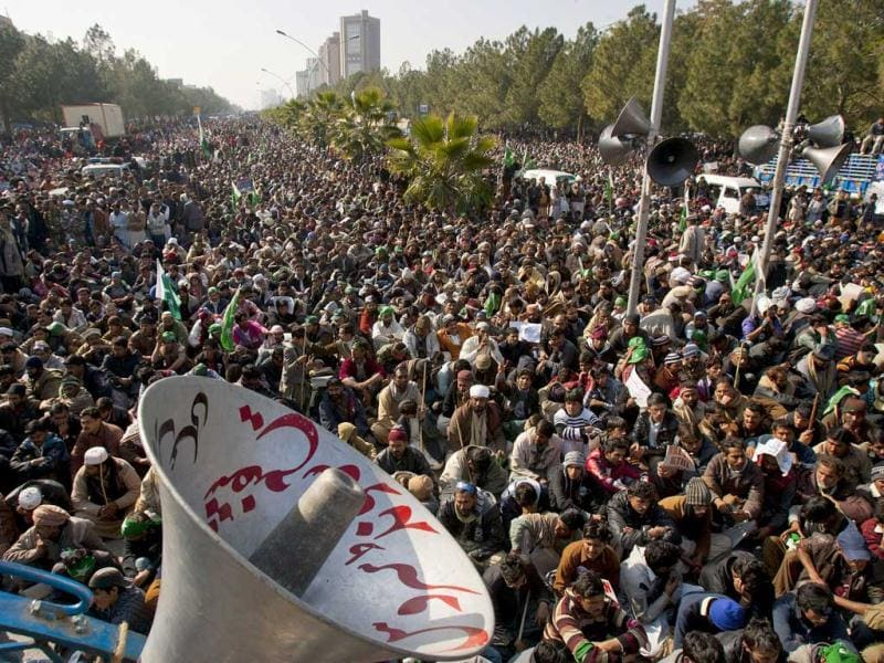 Supporters of Pakistani Sunni Muslim cleric Tahir-ul-Qadri listen to a speech by ul-Qadri at an anti-government rally in Islamabad, Pakistan. (AP Photo)