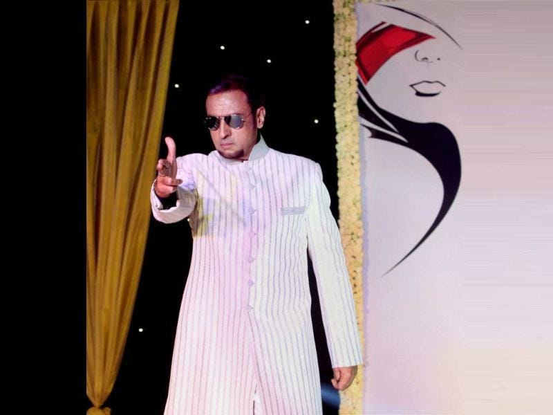 Gulshan Grover displays designer Neeta Lulla's creations during a charity fundraiser event of BETI movement for acid attack and rape victims across the country, in Mumbai on Monday night. (PTI Photo)