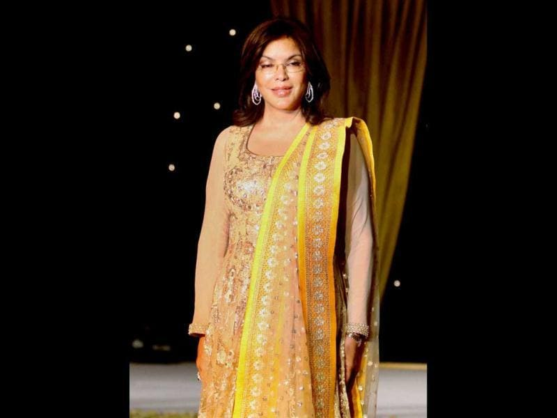 Bollywood veteran actor Zeenat Aman wearing designer Neeta Lulla's creations during a charity fundraiser event of BETI movement for acid attack and rape victims, in Mumbai on Monday night. (PTI Photo)