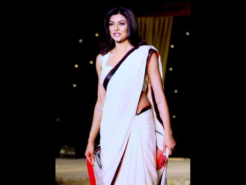Bollywood actor Sushmita Sen showcases a creation of designer Neeta Lulla during a charity event of BETI movement for acid attack and rape victims, in Mumbai on Monday night. (PTI Photo)