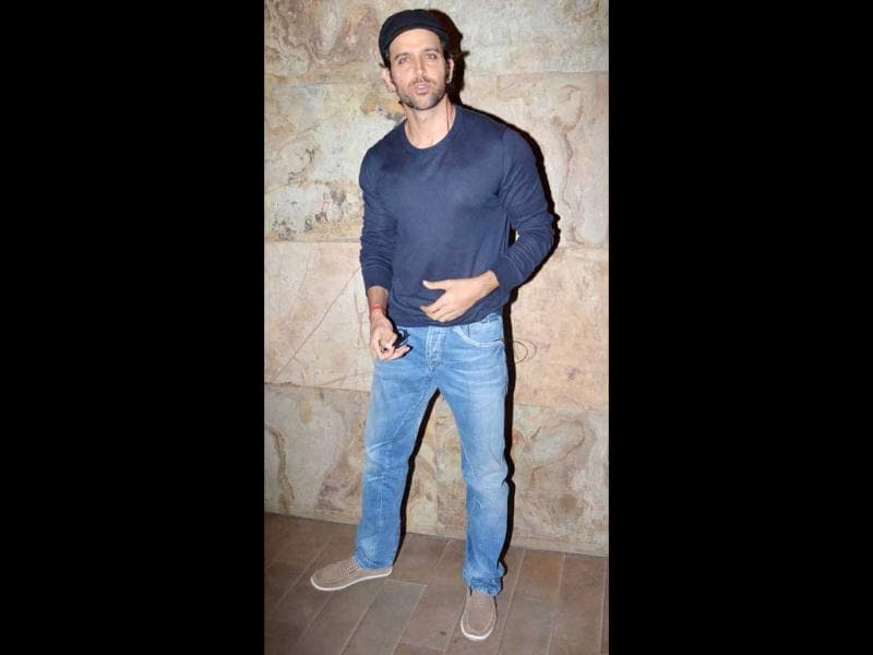 Cool dude Hrithik Roshan is plugged in while poses for the camera in a casual tee and denims.