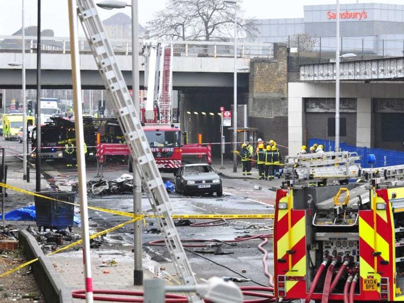 Debris lies on the ground after a helicopter crashed into a construction crane on top of St George's Wharf tower building, in London. AP photo