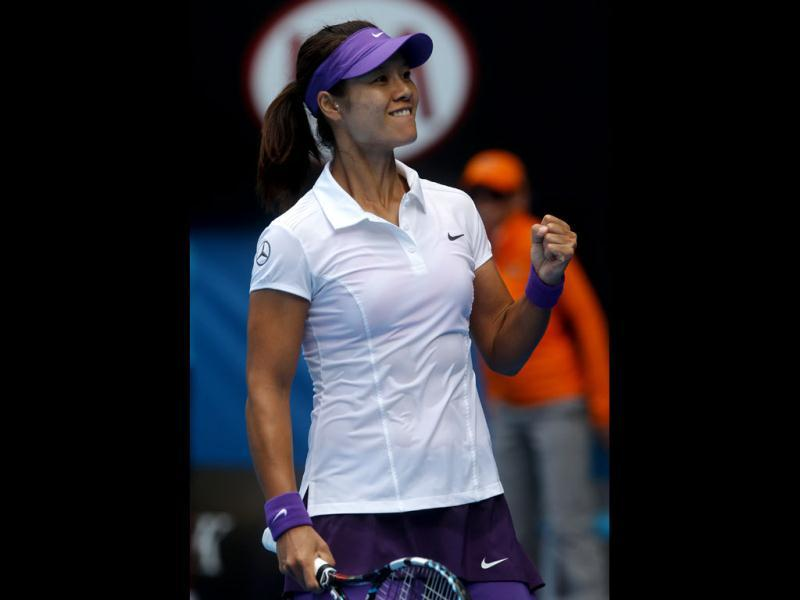 China's Li Na celebrates after defeating Romania's Sorana Cirstea during their third round match at the Australian Open tennis championship in Melbourne. AP