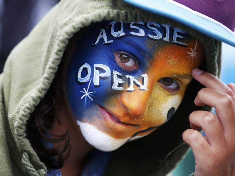 A fan with a painted face attends the Australian Open tennis tournament in Melbourne. Reuters