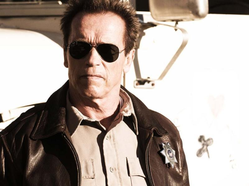 Arnold Schwarzenegger plays Ray Owens, the watchful sheriff of a sleepy border town Sommerton Junction.