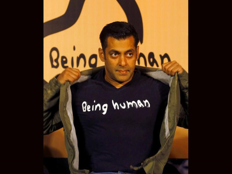 Salman Khan poses wearing a Being Human t-shirt during the launch of its first flagship store in Mumbai on Thursday, January 17, 2013. (AP Photo)
