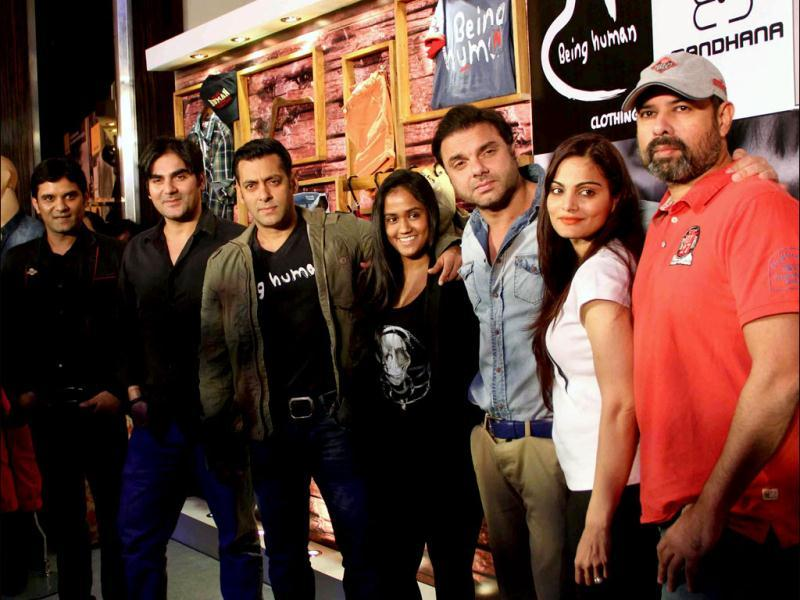 Bollywood actors Arbaaz Khan, Salman Khan and Sohail Khan along with others during a press conference announcing the launch of the flagship store of apparel brand Being Human, in Mumbai on Thursday. (UNI PHOTO)