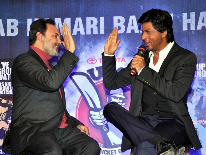 NDTV Chairperson Dr Pranay Roy and Shah Rukh Khan, Brand Ambassador at the announcement of NDTV's Toyota University Cricket Championship hi-five at the event.