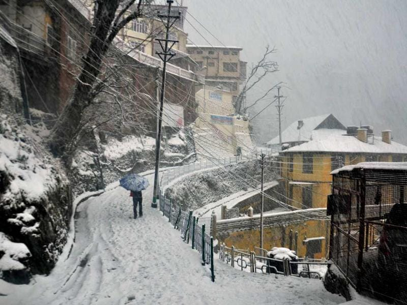 A person walks through snow in Shimla. HT/Santosh Rawat
