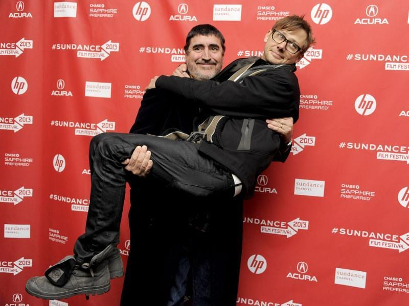 Alfred Molina, a cast member in Emanuel and the Truth about Fishes, picks up fellow cast member Jimmi Simpson at the premiere of the film at the 2013 Sundance Film Festival in Park City, Utah. AP