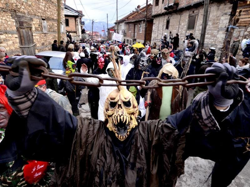 Masked villagers parade during the carnival in Macedonia's southwestern village of Vevcani. AP Photo