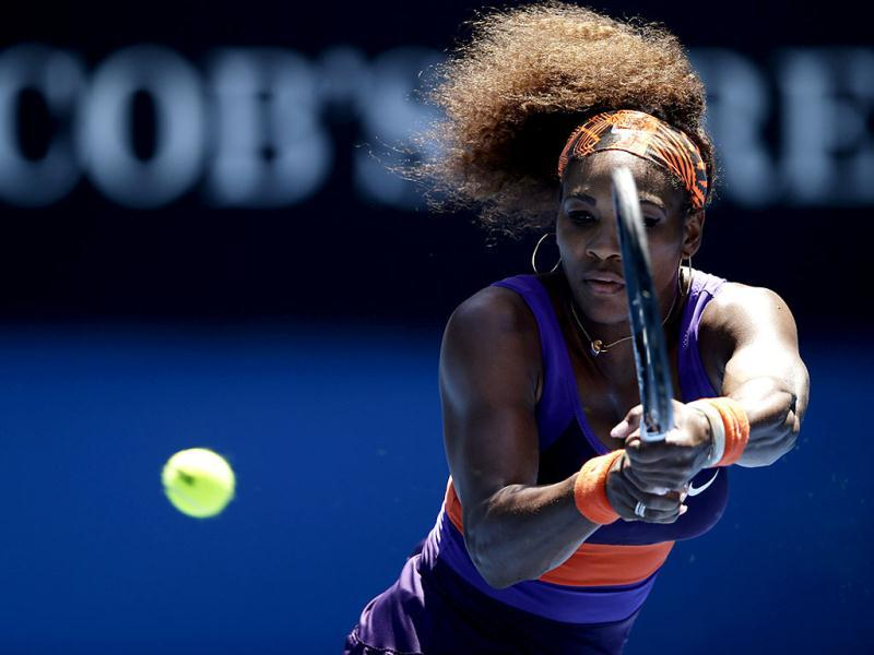 Serena Williams of the US hits a return to Japan's Ayumi Morita during their third round match at the Australian Open tennis championship in Melbourne. AP
