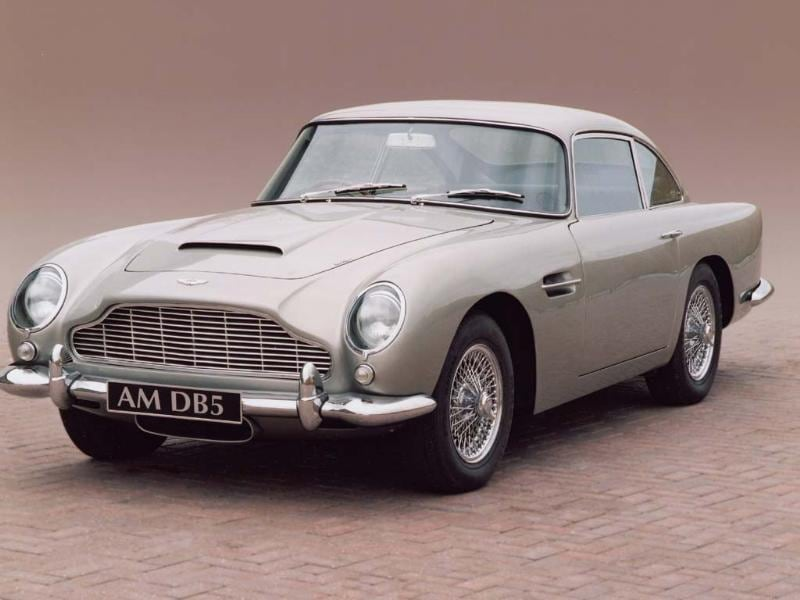 Launched in 1963, no one could have predicted the impact the DB5 would have on 1960s style or on popular culture. The first Aston with a 4-litre engine and five-speed gearbox, it faced still competition for sales from another, equally beautiful car at the time, the Jaguar E-Type. The DB5 sold for £4175, meaning that despite being twice as expensive as the Jag, Aston Martin actually lost upwards of £1000 on each model sold. Photo:AFP