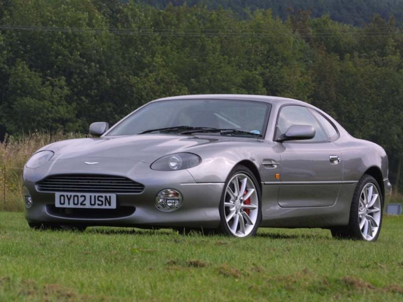 Despite being less powerful than the still in production Virage models and despite being built on a 25-year-old Jaguar XJS chassis with switch gear and door handles from the Ford parts bin, the DB7 firmly reestablished Aston Martin following its takeover by Ford. The first Aston to hit the 2000 sales mark, the original V8 engine was soon replaced by a V12 and the styling became progressively more masculine throughout its five-year lifespan. Photo:AFP