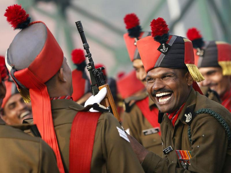 A soldier laughs while taking a break during a rehearsal for the Republic Day parade on a winter morning in New Delhi. Reuters photo