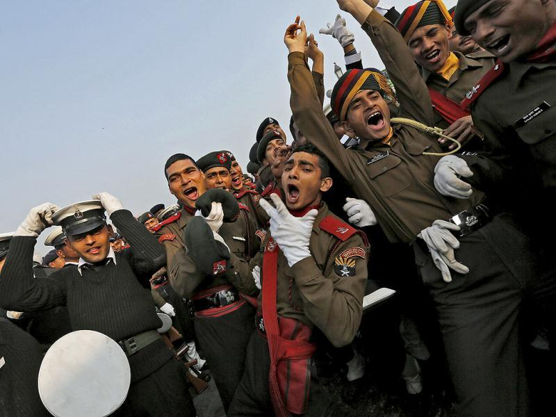 Soldiers dance as they take a break during a rehearsal for the Republic Day parade on a winter morning in New Delhi. Reuters photo