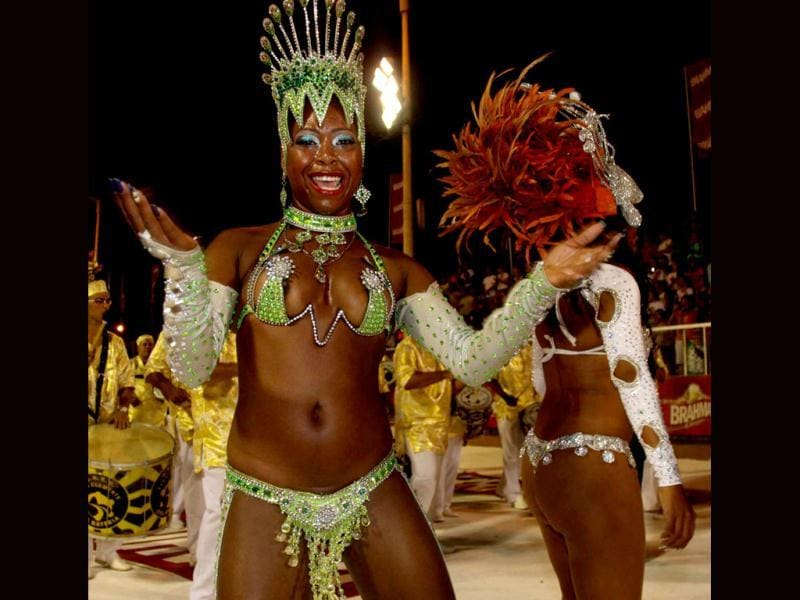 Scantily-clad dancers from San Clemente samba school in Rio de Janeiro, Brazil take part at the carnival in Encarncion, 375 km south of Asuncion. The