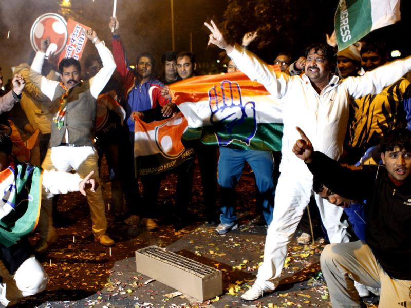 Congress supporters celebrate out side the AICC in New Delhi after Rahul Gandhi was appointed as the vice president of the party. HT photo