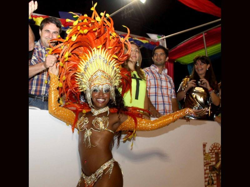Paraguayan President Federico Franco (L) with the dancers of San Clemente samba school in Rio de Janeiro, Brazil, during carnival in Encarncion. Paraguay's biggest carnival sees the groups of dancers and drummers of the traditional