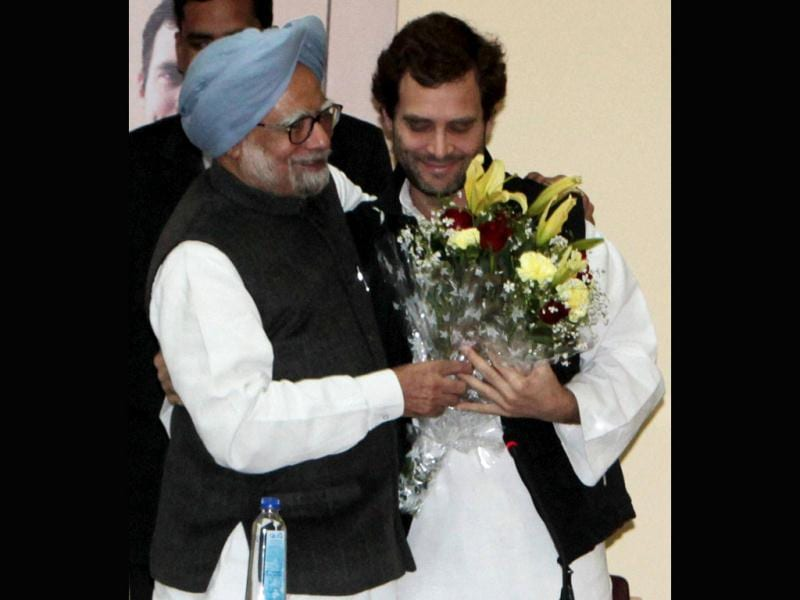 Prime Minister Manmohan Singh greets Rahul Gandhi after he was appointed as vice president of the Congress party in Jaipur. PTI Photo